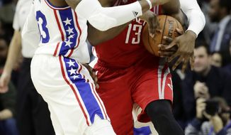 Philadelphia 76ers' Robert Covington, left, and Nerlens Noel, right, compete for the ball with Houston Rockets' James Harden during the first half of an NBA basketball game, Friday, Jan. 27, 2017, in Philadelphia. (AP Photo/Matt Slocum)