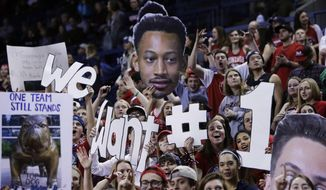 """Fans in the Gonzaga student section hold up signs stating """"We Want #1"""" signifying their desire for a #1 ranking for their team in the polls, before an NCAA college basketball game between Gonzaga and San Diego in Spokane, Wash., Thursday, Jan. 26, 2017. (AP Photo/Young Kwak)"""