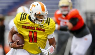 Tennessee quarterback Josh Dobbs (11) carries the ball during practice for Saturday's Senior Bowl NCAA college football game, Thursday, Jan. 26, 2017, in Mobile, Ala. (AP Photo/Butch Dill)