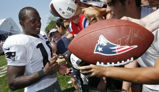 FILE - In this July 30, 2016, file photo, New England Patriots wide receiver Matthew Slater (18) signs autographs during NFL football training camp practice in Foxborough, Mass. New England's special team captain since 2011, the six-time Pro Bowl selection remains one the most respected players in the Patriots' locker room. He'll be trying for his second Super Bowl ring in Houston, a day after he receives the Bart Starr Award for character and leadership, which is voted on by his NFL peers. (AP Photo/Michael Dwyer, File)