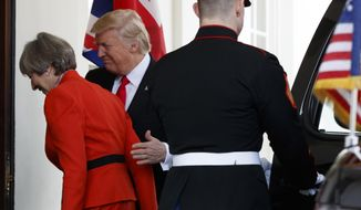 President Donald Trump welcomes British Prime Minister Theresa May to the White House in Washington, Friday, Jan. 27, 2017. (AP Photo/Evan Vucci)