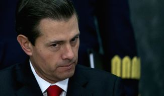 FILE - In this Jan. 23, 2017 file photo, Mexico's President Enrique Pena Nieto pause during a news conference at the Los Pinos presidential residence in Mexico City. (AP Photo/Marco Ugarte)
