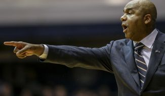 Georgetown coach John Thompson III motions to his players during the first half of the team's NCAA college basketball game against Butler in Indianapolis, Saturday, Jan. 28, 2017. Georgetown won 85-81. (AP Photo/AJ Mast)