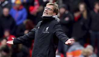Liverpool manager Jurgen Klopp gestures during the English FA Cup, fourth round  soccer match between Liverpool and Wolverhampton Wanderers, at Anfield, in Liverpool, England, Saturday,  Jan.  28, 2017. (Peter Byrne/PA via AP)
