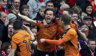 Wolverhampton Wanderers' Richard Stearman, centre, celebrates scoring his side's first goal of the game with his teammates during the FA Cup, fourth round  soccer match between Liverpool and Wolverhampton Wanderers, at Anfield, in Liverpool, England, Saturday,  Jan.  28, 2017. (Peter Byrne/PA via AP)