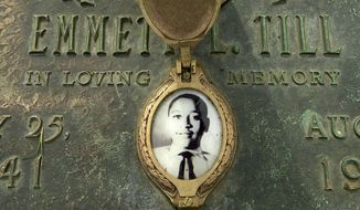 FILE - In this May 4, 2005 file photo, Emmett Till's photo is seen on his grave marker  in Alsip, Ill. The FBI announced Wednesday, May 4, 2005, that Till's body will be exhumed to conduct an autopsy, which was never performed, and determine the cause of death. The woman at the center of the trial of Emmett Till's alleged killers has acknowledged that she falsely testified he made physical and verbal threats, according to a new book. Historian Timothy B. Tyson told The Associated Press on Saturday, Jan. 28, 2017,  that Carolyn Donham broke her long public silence in an interview with him in 2008. (Robert A. Davis/Chicago Sun-Times via AP)