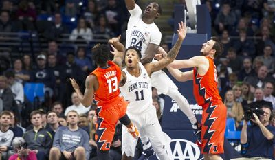 Penn State forward Mike Watkins, top and forward Lamar Stevens attempt to block Illinois guard Tracy Abrams from shooting the ball during an NCAA college basketball game Saturday, Jan 28, 2017, in State College, Pa. (Phoebe Sheehan/Centre Daily Times via AP)