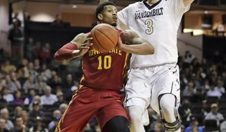 Iowa State forward Darrell Bowie (10) passes the ball away from Vanderbilt forward Luke Kornet (3) in the first half of an NCAA college basketball game, Saturday, Jan. 28, 2017, in Nashville, Tenn. (AP Photo/Mark Humphrey)