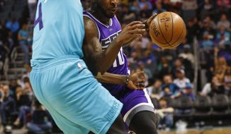 Sacramento Kings guard Ty Lawson, right, collides with Charlotte Hornets forward Michael Kidd-Gilchrist in the first half of a NBA basketball game in Charlotte, N.C., Saturday, Jan. 28, 2017. (AP Photo/Nell Redmond)
