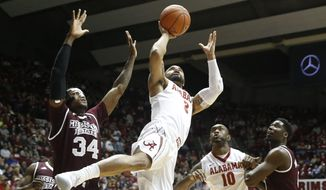 Alabama guard Corban Collins (3) gets off a shot in the lane against Mississippi State center Schnider Herard (34) during an NCAA college basketball game in Tuscaloosa, Ala., Saturday, Jan. 28, 2017. (Gary Cosby Jr./Tuscaloosa News via AP)