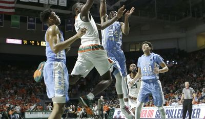 Miami guard Davon Reed (5) goes to the basket as North Carolina guard Kenny Williams (24) defends in the first half of an NCAA college basketball game, Saturday, Jan. 28, 2017, in Coral Gables, Fla. (AP Photo/Alan Diaz)