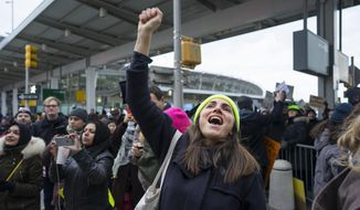 A protester raises her fist and shouts as she joins others assembled at John F. Kennedy International Airport in New York, Saturday, Jan. 28, 2017 after two Iraqi refugees were detained while trying to enter the country. On Friday, Jan. 27, President Donald Trump signed an executive order suspending all immigration from countries with terrorism concerns for 90 days. Countries included in the ban are Iraq, Syria, Iran, Sudan, Libya, Somalia and Yemen, which are all Muslim-majority nations. (AP Photo/Craig Ruttle)