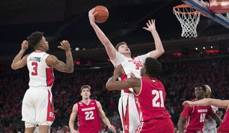 Rutgers center C.J. Gettys (34) goes to the basket past Wisconsin guard Khalil Iverson (21) during the first half of an NCAA college basketball game, Saturday, Jan. 28, 2017, at Madison Square Garden in New York. (AP Photo/Mary Altaffer)