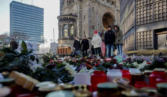 Victims of terrorist attacks were remembered in Paris, Berlin and Germany after Islamic State operatives infiltrated refugee flows. President Trump has placed a 120-day ban on immigration from what he considers high-risk Muslim-majority countries. (Associated Press)