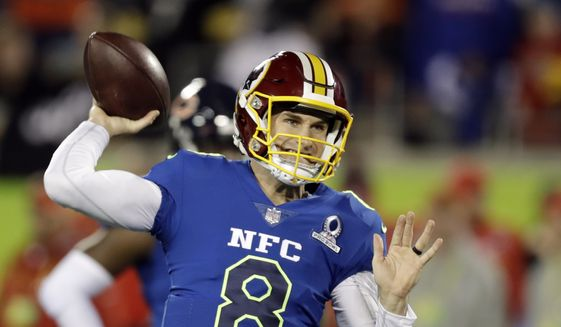 NFC quarterback Kirk Cousins (8), of the Washington Redskins warm up before the first half of the NFL Pro Bowl football game Sunday, Jan. 29, 2017, in Orlando, Fla. (AP Photo/Chris O'Meara)