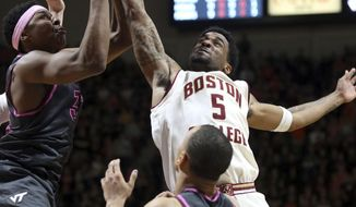Virginia Tech's Zach LeDay (32) battles for a defensive rebound against Boston College's Garland Owens (5)  in the first half of an NCAA college basketball game in Blacksburg, Va., Sunday Jan. 29 2017. (Matt Gentry/The Roanoke Times via AP)