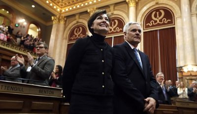 FILE - In this Jan. 10, 2017, file photo, Iowa Lt. Gov. Kim Reynolds and her husband Kevin stand as they arrive to listen to Iowa Gov. Terry Branstad deliver his annual condition of the state address before a joint session of the Iowa Legislature at the Statehouse in Des Moines, Iowa. Reynolds will soon become governor of Iowa, but she isn't in a hurry to draw attention to herself or point to future changes in priorities or style. For weeks since President Donald Trump announced he'd appoint Gov. Terry Branstad as ambassador to China, Reynolds has said little more than she's ready to be governor and intends to implement policies backed by her predecessor. (AP Photo/Charlie Neibergall, File)