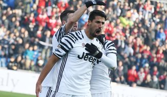 Juventus' midfielder Sami Khedira celebrates with teammates after scoring a goal during a Serie A soccer match between Juventus and Sassuolo, at the Mapei Stadium in Reggio Emilia, Italy, Sunday, Jan. 29, 2017. (Elisabetta Baracchi/ANSA via AP)