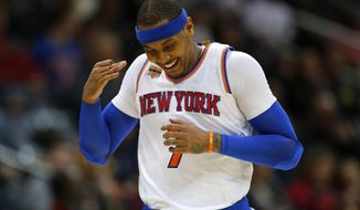 New York Knicks forward Carmelo Anthony (7) reacts after scoring a 3 pointer in the first half of an NBA basketball game against the Atlanta Hawks on Sunday, Jan. 29, 2017, in Atlanta. (AP Photo/Todd Kirkland)