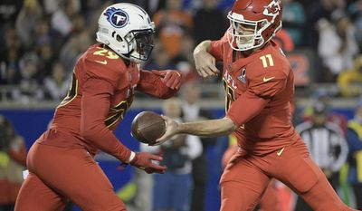 AFC quarterback Alex Smith (11), of the Kansas City Chiefs, hands the ball to AFC running back DeMarco Murray (29), of the Tennessee Titans, during the first half of the NFL Pro Bowl football game Sunday, Jan. 29, 2017, in Orlando, Fla. (AP Photo/Phelan M Ebenhack)