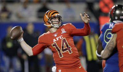 AFC quarterback Andy Dalton (14), of the Cincinnati Bengals, looks to pass, during the first half of the NFL Pro Bowl football game Sunday, Jan. 29, 2017, in Orlando, Fla. (AP Photo/Chris O'Meara)