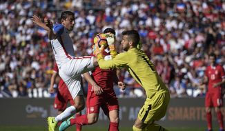 United States' Alejandro Bedoya, left, tries to shoot past Serbia's Filip Manojlovic during a friendly soccer match Sunday, Jan. 29, 2017, in San Diego. (AP Photo/Denis Poroy)