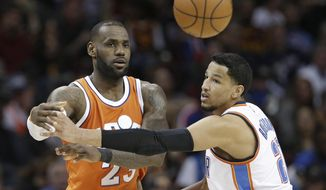 Cleveland Cavaliers' LeBron James, left, passes against Oklahoma City Thunder' Andre Roberson in the second half of an NBA basketball game, Sunday, Jan. 29, 2017, in Cleveland. (AP Photo/Tony Dejak)