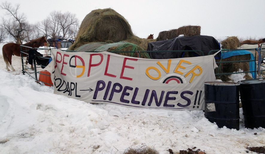 "Activists repeatedly have defied the Standing Rock Sioux's call for ""peaceful and prayerful"" protest. (Associated Press/File)"