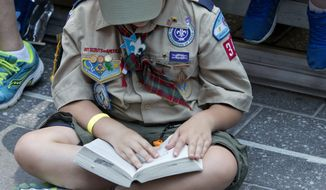 Boy Scouts of America will allow transgender children who identify as boys to enroll in scouting programs.  (AP Photo/Mary Altaffer)