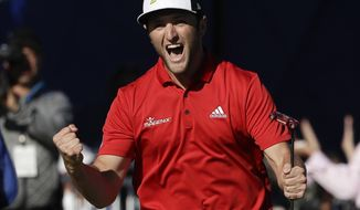Jon Rahm, of Spain, reacts after making a putt for eagle on the 18th hole of the Farmers Insurance Open golf tournament Sunday, Jan. 29, 2017, at Torrey Pines Golf Course in San Diego. Rahm won the tournament. (AP Photo/Gregory Bull)