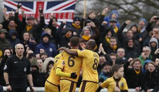 Sutton's players celebrate the goal of Sutton United's Jamie Collins during the English FA Cup soccer match between Sutton United and Leeds United at Borough Sports Ground in London, Sunday, Jan. 29, 2017. (AP Photo/Kirsty Wigglesworth)