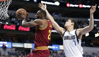 Cleveland Cavaliers forward LeBron James (23) goes up for a dunk as Dallas Mavericks forward Dwight Powell (7) defends during the first half of an NBA basketball game, Monday, Jan. 30, 2017, in Dallas. (AP Photo/Brandon Wade)