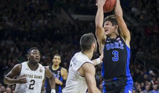 Duke's Grayson Allen (3) drives in with pressure from Notre Dame's Matt Farrell (5) and T.J. Gibbs (2) during the first half of an NCAA college basketball game, Monday, Jan. 30, 2017, in South Bend, Ind. (AP Photo/Robert Franklin)