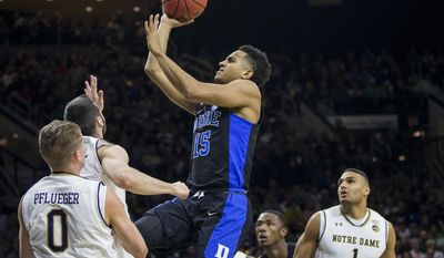 Duke's Frank Jackson (15) drives in for a shot over Notre Dame's Rex Pflueger (0), Matt Farrell (5) and Austin Torres (1) during the first half of an NCAA college basketball game, Monday, Jan. 30, 2017, in South Bend, Ind. (AP Photo/Robert Franklin)
