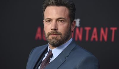 """FILE- In this Oct. 10, 2016, file photo, Ben Affleck arrives at the world premiere of """"The Accountant"""" at the TCL Chinese Theatre in Los Angeles. Affleck is no longer directing the Batman standalone movie for Warner Bros. In a statement Monday, Jan. 30, 2017, Affleck said it """"has become clear that I cannot do both jobs to the level they require"""" and that he and the studio are looking for a new director. (Photo by Jordan Strauss/Invision/AP, File)"""