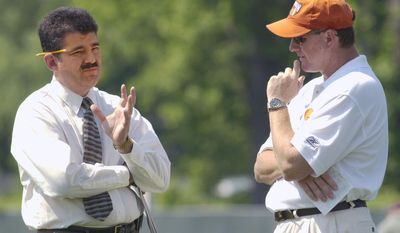 FILE - In this June 11, 2002, file photo, Cleveland Browns football director Pete Garcia, left, talks with coach Butch Davis after the first practice at the team's mini-camp in Berea, Ohio. Florida International football head coach Davis and FIU director of sports and entertainment Garcia have been joined at the hip for much of their football lives, and are again now. Davis' first class of FIU recruits will be unveiled Wednesday, Feb. 1, 2017, and he got plenty of help from Garcia in putting it together, just like at Miami two decades ago when they lured star after star after star to the Hurricanes. (AP Photo/Mark Duncan, File)