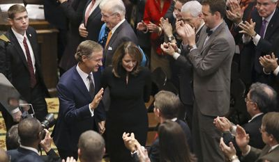 Gov. Bill Haslam and his wife, Crissy, leave the House chamber after Haslam gave his annual State of the State address to a joint convention of the Tennessee General Assembly, Monday, Jan. 30, 2017, in Nashville, Tenn. (AP Photo/Mark Humphrey)