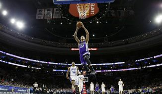 Sacramento Kings' Matt Barnes (22) goes up for a dunk during the first half of an NBA basketball game against the Philadelphia 76ers, Monday, Jan. 30, 2017, in Philadelphia. (AP Photo/Matt Slocum)