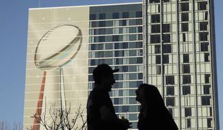Fans are seen near Minute Maid Park before opening night for the NFL Super Bowl 51 football game Monday, Jan. 30, 2017, in Houston. (AP Photo/Charlie Riedel)