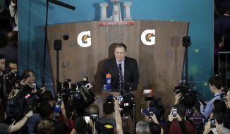 New England Patriots head coach Bill Belichick answers questions during opening night for the NFL Super Bowl 51 football game at Minute Maid Park Monday, Jan. 30, 2017, in Houston. (AP Photo/Eric Gay)