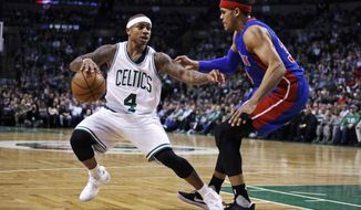 Boston Celtics guard Isaiah Thomas (4) drives to the basket against Detroit Pistons forward Tobias Harris, right, during the second quarter of an NBA basketball game in Boston, Monday, Jan. 30, 2017. (AP Photo/Charles Krupa)