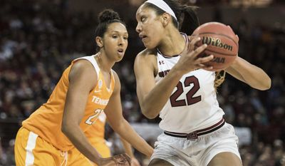 South Carolina forward A'ja Wilson (22) drives to the hoop against Tennessee center Mercedes Russell (21) during the first half of an NCAA college basketball game, Monday, Jan. 30, 2017, in Columbia, S.C. (AP Photo/Sean Rayford)