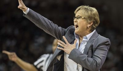Tennessee head coach Holly Warlick communicates with players during the first half of an NCAA college basketball game against South Carolina, Monday, Jan. 30, 2017, in Columbia, S.C. (AP Photo/Sean Rayford)