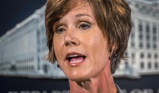 FILE - In this June 28, 2016, file photo, then-Deputy Attorney General Sally Yates speaks at the Justice Department in Washington. On Monday, Jan. 30, 2017, President Donald Trump fired acting Attorney General Sally Yates after she ordered Justice Department lawyers to stop defending refugee ban. (AP Photo/J. David Ake, File)