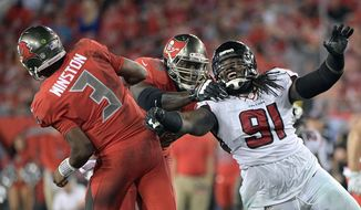 FILE - A Nov. 3, 2016, file photo, Tampa Bay Buccaneers quarterback Jameis Winston (3) throws a pass as tackle Demar Dotson (69) blocks Atlanta Falcons defensive tackle Courtney Upshaw (91) during the second half of an NFL football game in Tampa, Fla. They'll be on opposite sidelines in Sunday's Super Bowl, but there is a ton of respect between Patriots linebacker Dont'a Hightower and Falcons linebacker Courtney Upshaw. The duo were roommates at Alabama, where they first learned about playing in demanding environments with expectations, and won a pair of national championships in 2009 and 2011. But only one of them can earn his second Super Bowl ring.(AP Photo/Phelan M. Ebenhack, File)