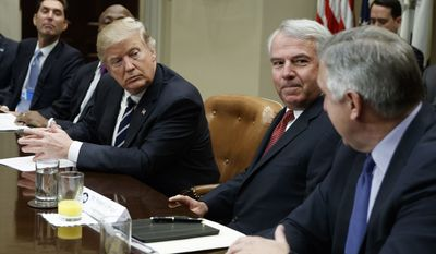 President Donald Trump listens during a meeting with pharmaceutical industry leaders in the Roosevelt Room of the White House in Washington, Tuesday, Jan. 31, 2017. From left are, PhRMA president Stephen Ubl, Merck CEO Kenneth Frazier, Trump, Celgene CEO Robert Hugin, and Amgen CEO Robert Bradway (AP Photo/Evan Vucci)