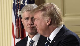 President Donald Trump claps after announcing 10th U.S. Circuit Court of Appeals Judge Neil Gorsuch as his choice for Supreme Court Justice during a televised address from the East Room of the White House in Washington, Tuesday, Jan. 31, 2017. (AP Photo/Susan Walsh)