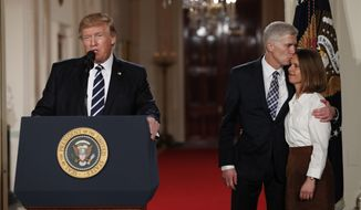 President Donald Trump speaks in the East Room of the White House in Washington, Tuesday, Jan. 31, 2017, to announce Judge Neil Gorsuch as his nominee for the Supreme Court. Gorsuch kisses his wife Louise. (AP Photo/Carolyn Kaster)