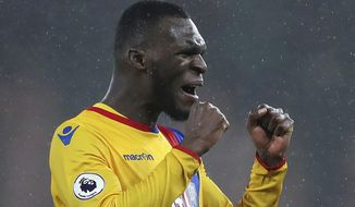 Crystal Palace's Christian Benteke, celebrates scoring his side's second goal during the English Premier League soccer match  between AFC Bournemouth and Crystal Palace, at the Vitality Stadium, Bournemouth, England, Tuesday, Jan. 31, 2017. (Andrew Matthews/PA via AP)