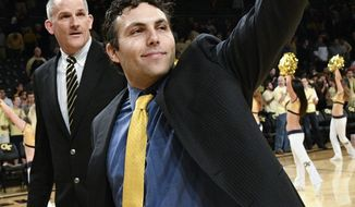 FILE - In this Jan. 25, 2017, file photo, Georgia Tech head coach Josh Pastner gestures to fans as he and assistant coach Eric Reveno walk off the court after their 78-56 win over Florida State in an NCAA basketball game in Atlanta. Pastner was expected to win no more than a couple of ACC games in his first season as Georgia Tech's coach, but the Yellow Jackets have surprisingly beaten two top 10 teams and another in the Top 25. (AP Photo/John Amis, File)